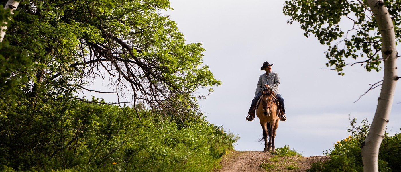 crop_Murphy-Larsen-Ranch-cowboy-on-trail.jpg